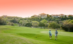 Golfers walking off the 17th green of the Fazio Foothills Course at Barton Creek Resort in Austin, Texas, USA.